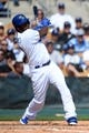 Mar 2, 2014; Phoenix, AZ, USA; Los Angeles Dodgers shortstop Hanley Ramirez (13) hits the ball against the San Diego Padres in the third inning at Camelback Ranch. Mandatory Credit: Joe Camporeale-USA TODAY Sports