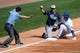 Mar 2, 2014; Phoenix, AZ, USA; Los Angeles Dodgers shortstop Alex Guerrero (7) slides into third base against the San Diego Padres at Camelback Ranch. Mandatory Credit: Joe Camporeale-USA TODAY Sports