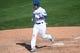 Mar 2, 2014; Phoenix, AZ, USA; Los Angeles Dodgers shortstop Alex Guerrero (7) scores a run against the San Diego Padres at Camelback Ranch. Mandatory Credit: Joe Camporeale-USA TODAY Sports