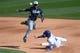 Mar 2, 2014; Phoenix, AZ, USA; San Diego Padres second baseman Alexi Amarista (5) throws the ball as Los Angeles Dodgers second baseman Justin Turner (10) slides into second base at Camelback Ranch. Mandatory Credit: Joe Camporeale-USA TODAY Sports