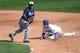 Mar 2, 2014; Phoenix, AZ, USA; Los Angeles Dodgers second baseman Justin Turner (10) and San Diego Padres second baseman Alexi Amarista (5) watch the ball at Camelback Ranch. Mandatory Credit: Joe Camporeale-USA TODAY Sports