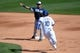 Mar 2, 2014; Phoenix, AZ, USA; San Diego Padres second baseman Alexi Amarista (5) throws the ball to first base in front of Los Angeles Dodgers second baseman Justin Turner (10) at Camelback Ranch. Mandatory Credit: Joe Camporeale-USA TODAY Sports