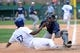 Mar 2, 2014; Phoenix, AZ, USA; San Diego Padres catcher Rocky Gale (83) tags out Los Angeles Dodgers infielder Darnell Sweeney (87) in the ninth inning against the San Diego Padres at Camelback Ranch.The game ended in a 3-3 tie. Mandatory Credit: Joe Camporeale-USA TODAY Sports