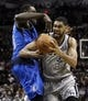 Mar 2, 2014; San Antonio, TX, USA; San Antonio Spurs forward Tim Duncan (21) drives to the basket as Dallas Mavericks center Samuel Dalembert (left)  defends during the first half at AT&T Center. Mandatory Credit: Soobum Im-USA TODAY Sports
