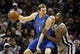 Mar 2, 2014; San Antonio, TX, USA; Dallas Mavericks forward Dirk Nowitzki (41) is defended by San Antonio Spurs forward Boris Diaw (right) during the first half at AT&T Center. Mandatory Credit: Soobum Im-USA TODAY Sports