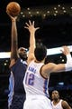 Mar 2, 2014; Oklahoma City, OK, USA; Charlotte Bobcats center Al Jefferson (25) attempts a shot over Oklahoma City Thunder center Steven Adams (12) during the first quarter at Chesapeake Energy Arena. Mandatory Credit: Mark D. Smith-USA TODAY Sports