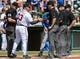 Mar 3, 2014; Lake Buena Vista, FL, USA; Atlanta Braves manager Fredi Gonzalez (33) greets the umpires before the spring training exhibition game against the New York Mets at Champion Stadium.  Mandatory Credit: Jonathan Dyer-USA TODAY Sports