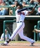 Mar 3, 2014; Lake Buena Vista, FL, USA; Atlanta Braves outfielder B.J. Upton (2)  watches a pop up in the first inning of the spring training exhibition game against the New York Mets at Champion Stadium. Mandatory Credit: Jonathan Dyer-USA TODAY Sports