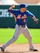 Mar 3, 2014; Lake Buena Vista, FL, USA; New York Mets Omar Quintanilla (0) makes a throw during the spring training exhibition game against the New York Mets at Champion Stadium. Mandatory Credit: Jonathan Dyer-USA TODAY Sports