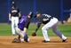 March 3, 2014; Peoria, AZ, USA; Colorado Rockies right fielder Charlie Blackmon (19) steals second against the tag of Seattle Mariners second baseman Robinson Cano (22) at Peoria Sports Complex. Mandatory Credit: Gary A. Vasquez-USA TODAY Sports