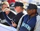March 3, 2014; Peoria, AZ, USA; Seattle Mariners manager Lloyd McClendon (23) watches game action against the Colorado Rockies at Peoria Sports Complex. Mandatory Credit: Gary A. Vasquez-USA TODAY Sports
