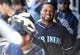 March 3, 2014; Peoria, AZ, USA; Seattle Mariners second baseman Robinson Cano (22) reacts after hitting an RBI single in the fifth inning against the Colorado Rockies at Peoria Sports Complex. Mandatory Credit: Gary A. Vasquez-USA TODAY Sports