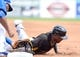 Mar 5, 2014; Dunedin, FL, USA; Pittsburg Pirates outfielder Chris Dickerson (25) slides back to first base on a pick off attempt in the first inning of the spring training exhibition game against the Toronto Blue Jays at Florida Auto Exchange Park. Mandatory Credit: Jonathan Dyer-USA TODAY Sports