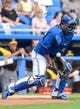 Mar 5, 2014; Dunedin, FL, USA; Toronto Blue Jays catcher Dioner Navarro (30) blocks a throw during the spring training exhibition game against the Pittsburg Pirates at Florida Auto Exchange Park. Mandatory Credit: Jonathan Dyer-USA TODAY Sports