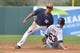 Mar 5, 2014; Kissimmee, FL, USA;  Houston Astros shortstop Carlos Correa (84) tags out Detroit Tigers left fielder Trevor Crowe (63) on a stolen base attempt during the third inning at Osceola County Stadium. Mandatory Credit: Tommy Gilligan-USA TODAY Sports