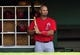 March 5, 2014; Scottsdale, AZ, USA; Los Angeles Angels first baseman Albert Pujols (5) watches game action before hitting against the San Francisco Giants  at Scottsdale Stadium. Mandatory Credit: Gary A. Vasquez-USA TODAY Sports
