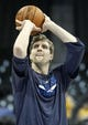 Mar 5, 2014; Denver, CO, USA;  Dallas Mavericks power forward Dirk Nowitzki (41) warms up before the start of the game against the Denver Nuggets at the Pepsi Center. Mandatory Credit: Isaiah J. Downing-USA TODAY Sports