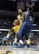 Mar 5, 2014; Denver, CO, USA; Denver Nuggets shooting guard Wilson Chandler (21) charges into Dallas Mavericks small forward Jae Crowder (9) in the second quarter at the Pepsi Center. Mandatory Credit: Isaiah J. Downing-USA TODAY Sports