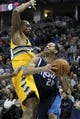 Mar 5, 2014; Denver, CO, USA; Denver Nuggets power forward Darrell Arthur (00) guards Dallas Mavericks point guard Devin Harris (20) in the fourth quarter at the Pepsi Center. The Nuggets won 115-110. Mandatory Credit: Isaiah J. Downing-USA TODAY Sports