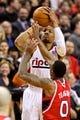 Mar 5, 2014; Portland, OR, USA; Portland Trail Blazers point guard Damian Lillard (0) shoots over Atlanta Hawks point guard Jeff Teague (0) at the Moda Center. Mandatory Credit: Craig Mitchelldyer-USA TODAY Sports