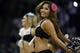 Mar 6, 2014; San Antonio, TX, USA; San Antonio Spurs cheerleader performs during the first half against the Miami Heat at AT&T Center. Mandatory Credit: Soobum Im-USA TODAY Sports