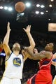 Mar 7, 2014; Oakland, CA, USA; Golden State Warriors center Andrew Bogut (12) controls a rebound against Atlanta Hawks point guard Jeff Teague (0) during the second quarter at Oracle Arena. Mandatory Credit: Kelley L Cox-USA TODAY Sports