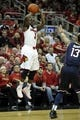 Mar 8, 2014; Louisville, KY, USA; Louisville Cardinals guard Chris Jones (3) shoots against Connecticut Huskies guard Shabazz Napier (13) during the second half at KFC Yum! Center. Louisville defeated Connecticut 81-48.  Mandatory Credit: Jamie Rhodes-USA TODAY Sports