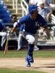 Mar 8, 2014; Phoenix, AZ, USA; Kansas City Royals right fielder Norichika Aoki (23) hits against the Milwaukee Brewers at Maryvale Baseball Park. Mandatory Credit: Rick Scuteri-USA TODAY Sports