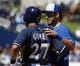 Mar 8, 2014; Phoenix, AZ, USA; Kansas City Royals first baseman Eric Hosmer (35) talks to Milwaukee Brewers center fielder Carlos Gomez (27) after Gomez was hit by a pitch in the first inning at Maryvale Baseball Park. Mandatory Credit: Rick Scuteri-USA TODAY Sports