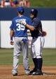 Mar 8, 2014; Phoenix, AZ, USA; Kansas City Royals first baseman Eric Hosmer (35) and Milwaukee Brewers third baseman Mark Reynolds (7) talks in the third inning at Maryvale Baseball Park. Mandatory Credit: Rick Scuteri-USA TODAY Sports