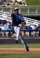 Mar 8, 2014; Phoenix, AZ, USA; Kansas City Royals shortstop Alcides Escobar (2) makes the off balance throw in the third inning against the Milwaukee Brewers at Maryvale Baseball Park. Mandatory Credit: Rick Scuteri-USA TODAY Sports