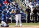 Mar 8, 2014; Phoenix, AZ, USA; MLB review a play in the third inning of a game between the Kansas City Royals and the Milwaukee Brewers at Maryvale Baseball Park. Mandatory Credit: Rick Scuteri-USA TODAY Sports