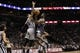 Mar 8, 2014; San Antonio, TX, USA; Orlando Magic guard E'Twaun Moore (55) shoots the ball as San Antonio Spurs guard Danny Green (4) defends during the second half at AT&T Center. The Spurs won 121-112. Mandatory Credit: Soobum Im-USA TODAY Sports
