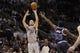Mar 8, 2014; San Antonio, TX, USA; San Antonio Spurs guard Manu Ginobili (20) shoots the ball over Orlando Magic guard E'Twaun Moore (55) during the second half at AT&T Center. The Spurs won 121-112. Mandatory Credit: Soobum Im-USA TODAY Sports