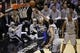 Mar 8, 2014; San Antonio, TX, USA; Orlando Magic guard Arron Afflalo (4) shoots the ball past San Antonio Spurs forward Tim Duncan (21) during the second half at AT&T Center. The Spurs won 121-112. Mandatory Credit: Soobum Im-USA TODAY Sports