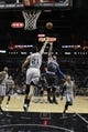 Mar 8, 2014; San Antonio, TX, USA; Orlando Magic guard Jameer Nelson (14) shoots the ball over San Antonio Spurs forward Tim Duncan (21) during the second half at AT&T Center. The Spurs won 121-112. Mandatory Credit: Soobum Im-USA TODAY Sports