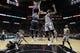 Mar 8, 2014; San Antonio, TX, USA; Orlando Magic forward Tobias Harris (12) shoots the ball past San Antonio Spurs forward Marco Belinelli (3) during the second half at AT&T Center. The Spurs won 121-112. Mandatory Credit: Soobum Im-USA TODAY Sports