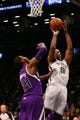 Mar 9, 2014; Brooklyn, NY, USA; Brooklyn Nets center Jason Collins (98) shoots over Sacramento Kings power forward Jason Thompson (34) during the third quarter at Barclays Center. Brooklyn Nets won 104-89.  Mandatory Credit: Anthony Gruppuso-USA TODAY Sports