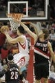 Mar 9, 2014; Houston, TX, USA; Houston Rockets point guard Jeremy Lin (7) scores against Portland Trail Blazers center Robin Lopez (42) during the overtime period at Toyota Center. Mandatory Credit: Andrew Richardson-USA TODAY Sports