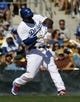 Mar 10, 2014; Phoenix, AZ, USA; Los Angeles Dodgers right fielder Yasiel Puig (66) hits in the fourth inning against the Oakland Athletics at Camelback Ranch. Mandatory Credit: Rick Scuteri-USA TODAY Sports