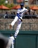 Mar 10, 2014; Phoenix, AZ, USA; Los Angeles Dodgers shortstop Dee Gordon (9) makes the off balance throw for the out against the Oakland Athletics in the fourth inning at Camelback Ranch. Mandatory Credit: Rick Scuteri-USA TODAY Sports