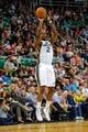 Mar 10, 2014; Salt Lake City, UT, USA; Utah Jazz power forward Marvin Williams (2) shoots a jump shot against the Atlanta Hawks during the fourth quarter at EnergySolutions Arena. The Atlanta Hawks won the game 112-110. Mandatory Credit: Chris Nicoll-USA TODAY Sports