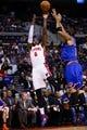 Nov 19, 2013; Auburn Hills, MI, USA; Detroit Pistons small forward Josh Smith (6) shoots on New York Knicks power forward Kenyon Martin (3) at The Palace of Auburn Hills. Mandatory Credit: Rick Osentoski-USA TODAY Sports