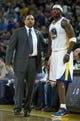 Mar 11, 2014; Oakland, CA, USA; Golden State Warriors head coach Mark Jackson speaks with center Jermaine O'Neal (7) on the sideline during the first quarter against the Dallas Mavericks at Oracle Arena. Mandatory Credit: Kelley L Cox-USA TODAY Sports