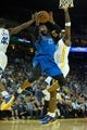 Mar 11, 2014; Oakland, CA, USA; Dallas Mavericks guard Vince Carter (25) scores a basket between Golden State Warriors forward Harrison Barnes (40) and center Jermaine O'Neal (7) during the second quarter at Oracle Arena. Mandatory Credit: Kelley L Cox-USA TODAY Sports