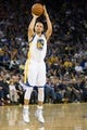 Mar 11, 2014; Oakland, CA, USA; Golden State Warriors guard Stephen Curry (30) scores a three point basket against the Dallas Mavericks during the fourth quarter at Oracle Arena. The Golden State Warriors defeated the Dallas Mavericks 108-85. Mandatory Credit: Kelley L Cox-USA TODAY Sports