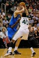 Mar 12, 2014; Salt Lake City, UT, USA; Dallas Mavericks forward Dirk Nowitzki (41) shoots a jump shot over Utah Jazz forward Jeremy Evans (40) during the second quarter at EnergySolutions Arena. Mandatory Credit: Chris Nicoll-USA TODAY Sports