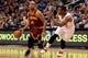 Mar 12, 2014; Phoenix, AZ, USA; Cleveland Cavaliers guard Jarrett Jack (1) dribbles the ball around Phoenix Suns guard Eric Bledsoe (2) in the first half at US Airways Center. Mandatory Credit: Jennifer Stewart-USA TODAY Sports