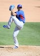 Mar 15, 2014; Surprise, AZ, USA; Chicago Cubs pitcher Chang Yong Lim (12) throws during the sixth inning against the Kansas City Royals at Surprise Stadium. Mandatory Credit: Christopher Hanewinckel-USA TODAY Sports