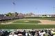 Mar 15, 2014; Phoenix, AZ, USA; A general view of game action between the Oakland Athletics and the Texas Rangers at Phoenix Municipal Stadium. The Rangers won 16-15. Mandatory Credit: Joe Camporeale-USA TODAY Sports